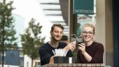 Nia and Douglas raise a glass outside Wahaca's Cardiff restaurant