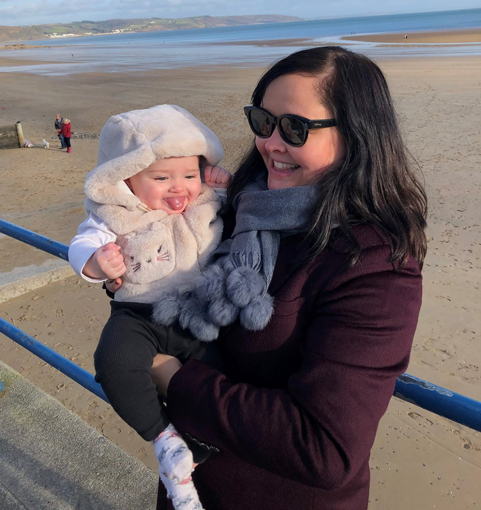 Scott Bower's wife and new daughter at the beach