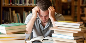 Tired student having a lot to read