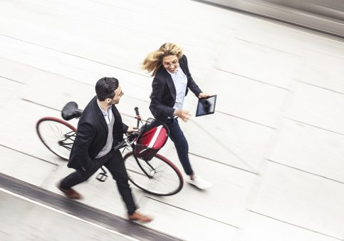 Active travel: two people walking/cycling to work