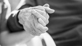 Elderely people holding hands