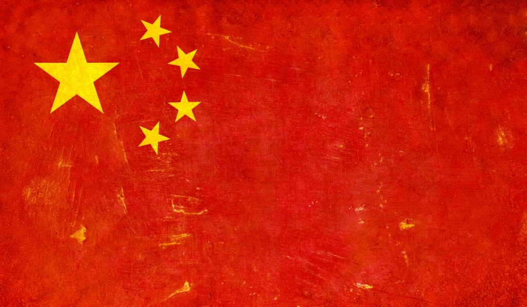Grunge Chinese flag on rough edged wall background