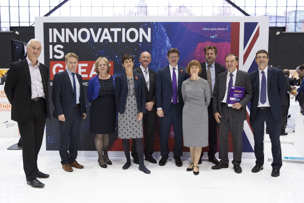 Science and Innovation Audits (SIAs) winners pose with Rt Hon Greg Clark MP and Innovate UK's Dr Ruth McKernan. (L-R) Neil Bradshaw, University of Bristol, Sam Turner, University of Sheffield, Elizabeth Treasure, Cardiff University, Pam Waddell, Birmingham Science City, Philip Extance, Aston University, Rt Hon Greg Clark MP, Secretary of State for Business, Energy and Industrial Strategy, Dr Ruth McKernan, Innovate UK Chief Executive, Kevin Collins, University of Edinburgh,  Luke Georghiou, Manchester Science City and Stephen Decent, Lancaster University, at Innovate 2016, Manchester Central Conference Centre, 3rd November 2016